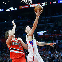 09 November 2016: Los Angeles Clippers guard Austin Rivers (25) goes for the layup past Portland Trail Blazers forward Meyers Leonard (11) during the LA Clippers 111-80 victory over the Portland Trail Blazers, at the Staples Center, Los Angeles, California, USA.