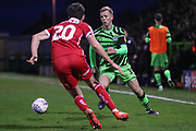 Forest Green Rovers Nathan McGinley(19) takes on Scunthorpe United's Alex Gilliead(20) during the EFL Sky Bet League 2 match between Forest Green Rovers and Scunthorpe United at the New Lawn, Forest Green, United Kingdom on 7 December 2019.