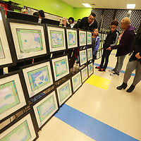 Joshua Standifer, from left, and his family Riley, 6, Madison, 16, Felicia, and Jodie Gabreil look at the art done by the students at Joyner Elementary School.