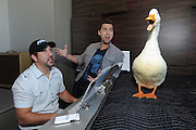 Joey Fatone, left, Lance Bass and the Aflac Duck sing together at a New York vocal studio, Monday, Sept. 23, 2013.  The Aflac Duck, in town for Advertising Week, is celebrating his comeback from injuries that left him unable to quack.  (Photo by Diane Bondareff/Invision for Aflac/AP Images)
