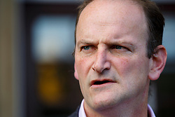 © Licensed to London News Pictures. 09/10/2014. Clacton, UK. Douglas Carswell, ex-Tory MP and new UKIP MP candidate for Clacton-on-Sea visits a polling station at  Clacton Town Hall during the by-election on Thursday, 9 October, 2014. Photo credit : Tolga Akmen/LNP