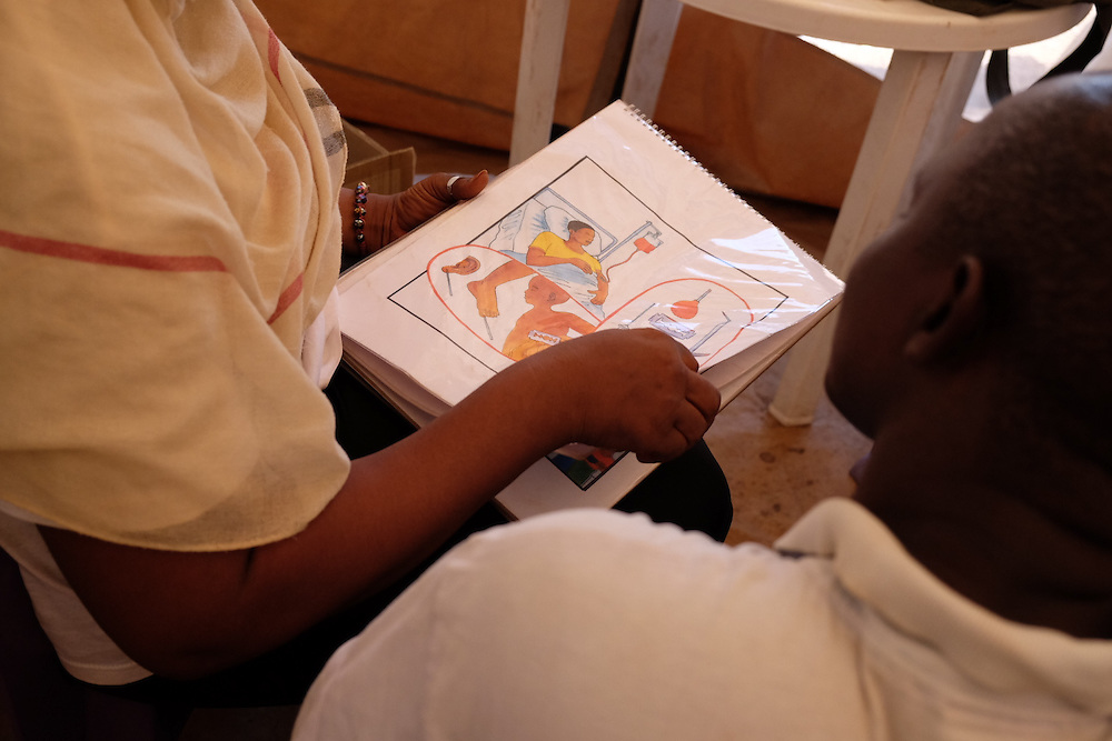 A man participates in a HIV prevention awareness session with an activist at the MSF mobile clinic in the neighbourhood of Tombolia, Conakry, Guinea on March 18, 2016. MSF launched a HIV testing campaign in Conakry with the support of health authorities moving throughout several neighbourhoods throughout 2016.<br /> <br /> Despite countries in West and Central Africa having a relatively low HIV prevalence (