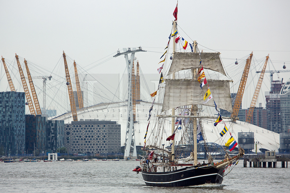 © Licensed to London News Pictures. 07/09/2014. Lady of Avenel and the O2. The biggest tall ships event in London for 25 years is continuing across this weekend. Visitors took the opportunity to sail in tall ships up and down the Thames and go onboard those moored at Greenwich and Woolwich. The Royal Greenwich Tall Ships Festival concludes on Tuesday when all 50 vessels will sail down river together. Credit : Rob Powell/LNP