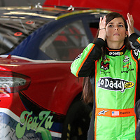 NASCAR Sprint Cup driver Danica Patrick prepares to put on her helmet in the garage area, during a NASCAR Daytona 500 practice session at Daytona International Speedway on Wednesday, February 20, 2013 in Daytona Beach, Florida.  (AP Photo/Alex Menendez)