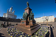 Senate Square; the lutheran Cathedral. Statue of Alexander II, a Russian Tsar. Accordeon player.