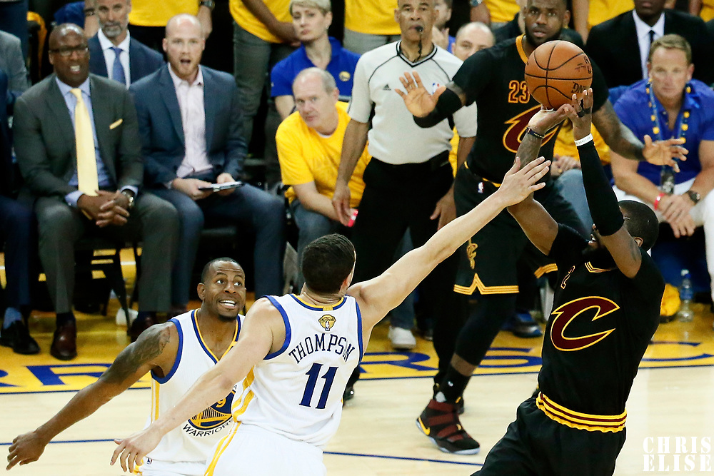 12 June 2017: Cleveland Cavaliers guard Kyrie Irving (2) takes a jump shot over Golden State Warriors guard Klay Thompson (11) during the Golden State Warriors 129-120 victory over the Cleveland Cavaliers, in game 5 of the 2017 NBA Finals, at the Oracle Arena, Oakland, California, USA.
