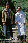 "El Bulli. Famous extravagant restaurant run by Chef Ferran Adria (r.) and Manager Juli Soler (l.), here with a bronze statue of ""El Bulli"", the former owner's beloved pet dog."