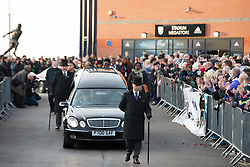 © Licensed to London News Pictures. 30/01/2018. The funeral of footballer Cyrille Regis took place in West Bromwich today. The hearse made it's way past the football ground where he played as family, friends and fans said their final farewell. Pictured, the hearse leaves the Hawthorns. Photo credit: Dave Warren/LNP
