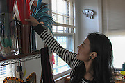 Kearny, New Jersey. November 19, 2013. Yadira Aleman organizes the feathers used in dance performances in her home in Kearny. Photo by Maya Rajamani/NYCity Photo Wire