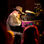 "Malcolm John ""Mac"" Rebennack, Jr. (born November 21, 1940), better known by the stage name Dr. John (also Dr. John Creaux, or Dr. John the Night Tripper), is an American singer-songwriter, pianist and guitarist, whose music combines blues, pop, jazz as well as zydeco, boogie woogie and rock and roll.["