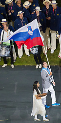 27.07.2012, Olympia Park, London, GBR, Olympia 2012, Eroeffungsfeier, im Bild Einzug der Nationen, Slovenien // Entrance of the Nations, Peter Kauzer of Slovenia during opening ceremony at the 2012 Summer Olympics at Olympic Park London, United Kingdom on 2012/07/27. EXPA Pictures © 2012, PhotoCredit: EXPA/ Johann Groder