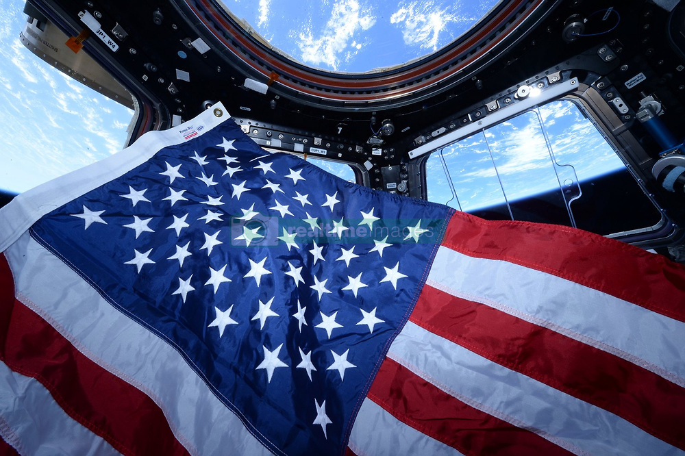 July 4, 2018 - International Space Station, Earth Orbit - An American flag floats inside the copula module in the International Space Station as the crew celebrates the United States Independence Day July 4, 2018 in Earth Orbit. (Credit Image: © Nasa/Planet Pix via ZUMA Wire)