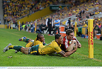 22 June 2013; George North, British & Irish Lions, goes over to score his side's second try, which was subsequently disallowed, despite the efforts of Will Genia, behind, and Israel Folau, Australia. British & Irish Lions Tour 2013, 1st Test, Australia v British & Irish Lions, Suncorp Stadium, Brisbane, Queensland, Australia. Picture credit: Stephen McCarthy / SPORTSFILE