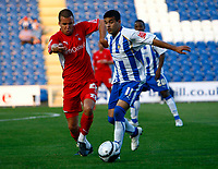 Football Carling Cup First Round Colchester United v Leyton Orient Simon Hackney of Colchester United Jimmy Smith of Leyton Orient at Weston Homes Community Stadium, Colchester 11/08/2009 Credit: Colorsport / Kieran Galvin