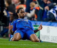 LONDON, ENGLAND - Wednesday, April 30, 2008: Chelsea's Didier Drogba arrogantly dives in front of the Liverpool bench to celebrate his opening goal during the UEFA Champions League Semi-Final 2nd Leg match at Stamford Bridge. (Photo by David Rawcliffe/Propaganda)