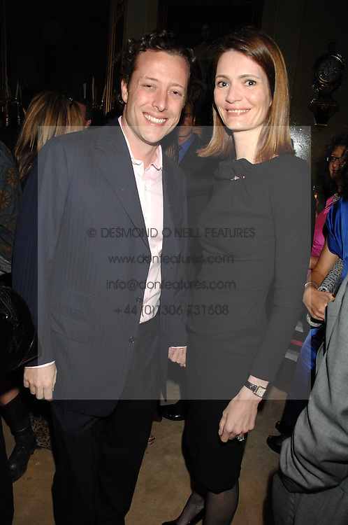 PLUM SYKES and her husband TOBY ROWLANDS at the engagement party of Vanessa Neumann and William Cash held at 16 Westbourne Terrace, London W2 on 15th April 2008.<br />