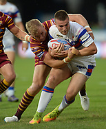 Aaron Murphy of Huddersfield Giants stops Max Jowitt of Wakefield Trinity during the Betfred Super League match at the John Smiths Stadium, Huddersfield<br /> Picture by Richard Land/Focus Images Ltd +44 7713 507003<br /> 27/07/2018