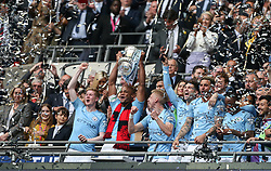 Manchester City celebrate as Vincent Kompany lifts the trophy - Mandatory by-line: Arron Gent/JMP - 18/05/2019 - FOOTBALL - Wembley Stadium - London, England - Manchester City v Watford - Emirates FA Cup Final