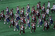 Hong Kong. . pipes and drums bands of the Gurkhas with the auxiliary police playing at Shatin jockey club horse race field.² Shatin   / Orchestre de cornemuses des Ghurkhas et de la police auxiliaire sur le champs de courses du jockey club à Shatin.