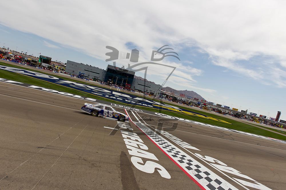 LAS VEGAS, NV - MAR 11, 2012:  Mark Martin (55) crosses the finish line at the Kobalt Tools 400 NASCAR race in Las Vegas, NV.