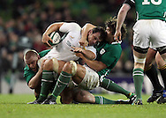 Photo © SPORTZPICS / SECONDS LEFT IMAGES 2010/Colm O'Neill - South Africa's Bismarck du Plessis (C) is tackled by Tom Court (L) and Donncha O'Callaghan (R) of IReland - Ireland v South Africa - Guinness Series 2010 - Aviva Stadium - Dublin - Ireland - 06/11/10 - All rights reserved