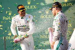 March 17, 2019 - Albert Park, VIC, U.S. - ALBERT PARK, VIC - MARCH 17: Champagne flies with Valtteri Bottas and Lewis Hamilton on the podium at The Australian Formula One Grand Prix on March 17, 2019, at The Melbourne Grand Prix Circuit in Albert Park, Australia. (Photo by Speed Media/Icon Sportswire) (Credit Image: © Steven Markham/Icon SMI via ZUMA Press)