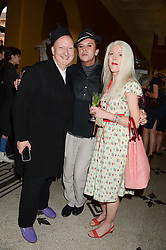 Left to right, STEPHEN JONES, STEVE STRANGE and SCARLETT CANNON at the opening of Club To Catwalk: London Fashion In The 1980's an exhibition at The V&A Museum, London on 8th July 2013.