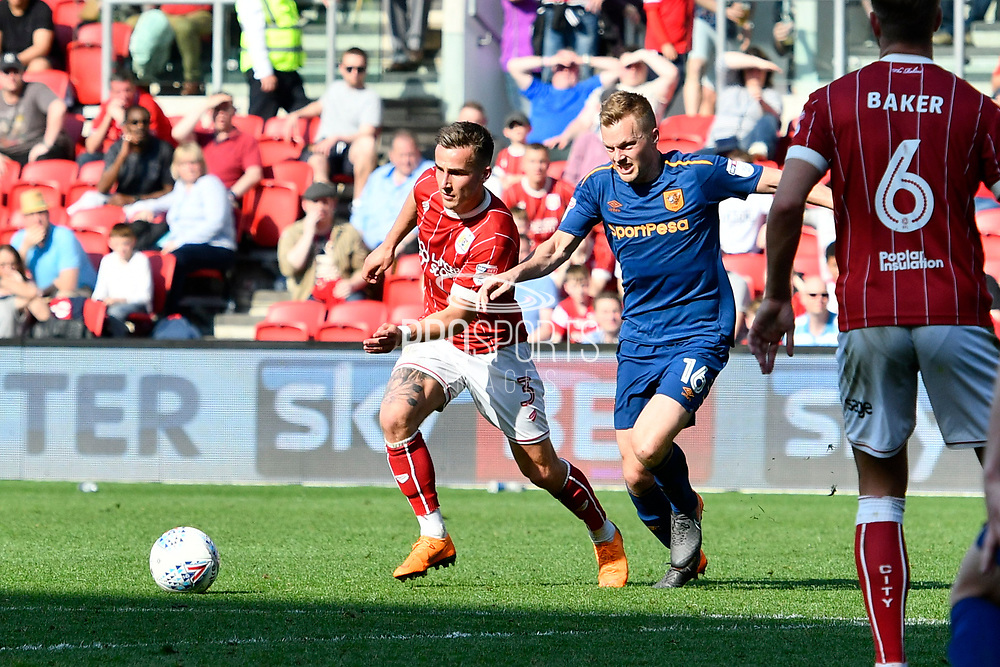 Joe Bryan (3) of Bristol City battles for possession with Sebastian Larsson (16) of Hull City before scoring the equaliser to make the score 5-5 during the EFL Sky Bet Championship match between Bristol City and Hull City at Ashton Gate, Bristol, England on 21 April 2018. Picture by Graham Hunt.