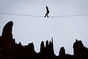 Kevander Baldwin walks a line that seems to hover over the Fisher Towers.<br />
