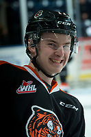 KELOWNA, CANADA - JANUARY 30: Baxter Anderson #11 of the Medicine Hat Tigers hams it up for the camera during warm up against the Kelowna Rockets on January 30, 2017 at Prospera Place in Kelowna, British Columbia, Canada.  (Photo by Marissa Baecker/Shoot the Breeze)  *** Local Caption ***