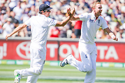 © Licensed to London News Pictures. 27/12/2013. Stuart Broad celebrates with captain Alastair Cook during Day 2 of the Ashes Boxing Day Test Match between Australia Vs England at the MCG on 27 December, 2013 in Melbourne, Australia. Photo credit : Asanka Brendon Ratnayake/LNP