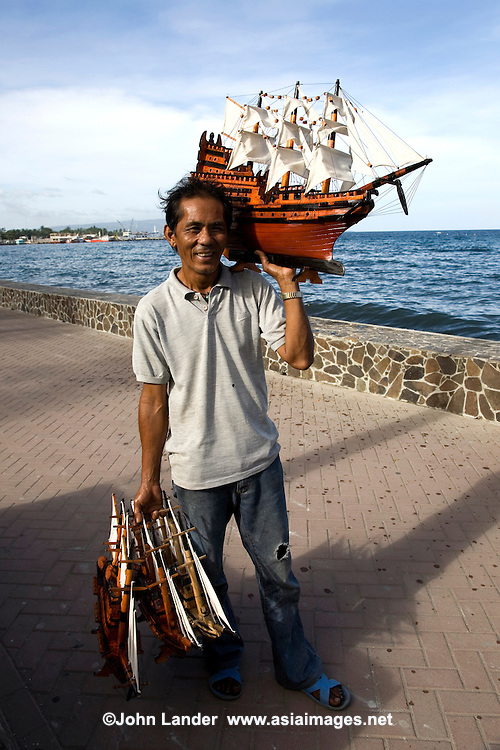 Model Ship Vendor - Rizal Boulevard in Dumaguete  was named after Dr. Jose Rizal, it is said that Dr Rizal made a brief visit and took a stroll here before departing to neighboring Dapitan where he was exiled for four years following the Spanish authorities' suspicion that he was about to lead a revolution.  The Boulevard is immediately visible when coming into Dumaguete port via any sea vessel. From the white lamp posts lining up the stretch to the stately palms swaying in the breeze, Rizal Boulevard is a favorite landmark for residents and visitors.