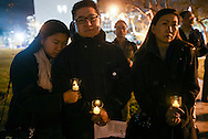Supporters holds lit candles during a candlelight vigil in remembrance and support of 'Comfort Women', Japanese military sexual slavery victims during World War II, at Glendale Peace Monument on January 5, 2016 in Glendale, California. AFP PHOTO / Ringo Chiu