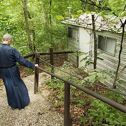 Members of the Society of the Mother of Peace live in hermitages, tiny houses of one bedroom and a bathroom in 128 square feet. Separated by at least 100 feet they afford solitude in the deciduous woods at the Mary of the Font Solitude in Jefferson County. Father Placid Guste, returned to his hermitage to pray.<br /> <br /> <br /> Teak Phillips | St. Louis Review | @TeakPhillips