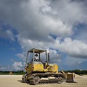 MAY 29, 2015---GRAND CAYMAN, CAYMAN ISLANDS----<br /> Bulldozer operator Derick Foster  filling in part of the lot where the CIFA (Cayman Islands Football Association) has been expected to build facilities since 2009. This project started about one month ago. The former President of the CIFA, Jeffrey Webb, was arrested in Zurich for alleged corruption. Webb was President of CIFA and CONCACAF and is Vice PResident of FIFA. (Photo by Angel Valentin/Freelance)