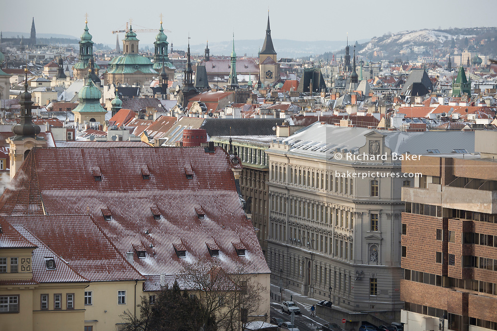 Views from Letna Park over rooftops and tall church steeples in Stare Mesto, the city's old quarter - on 18th March, 2018, in Prague, the Czech Republic. Like Rome, Prague is built on seven hills.