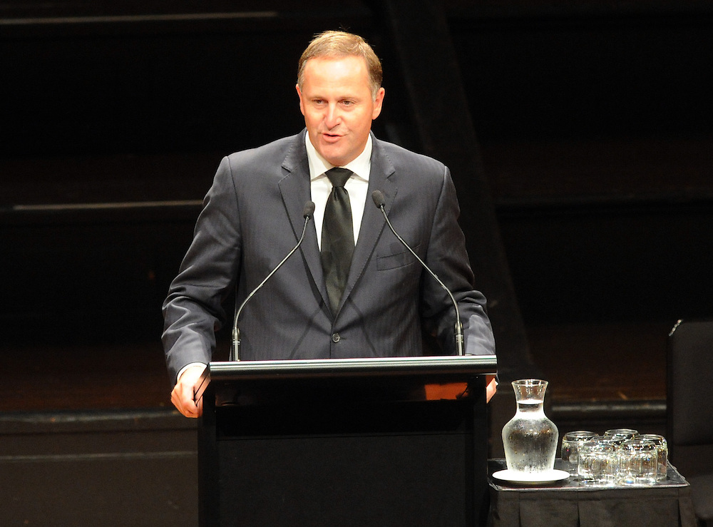 Prime Minister John Key speaks at the funeral of Hugh Richmond Lloyd Morrison, Town Hall, Wellington, New Zealand, Friday, February 24, 2012. Credit:SNPA / Ross Setford