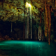 Millions of years ago oceans covered the Yucatan peninsula until the end of the last ice age when the waters descended approximately 250 feet. The limestone caves were exposed and some of them collapsed. But the ones that did not, started filtering rainfall water and with the help of time created stalactites and stalagmites. Eventually some parts of this caverns collapsed letting the sunlight create the most incredible reflections and shapes within.