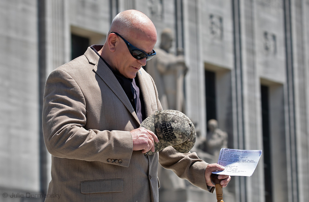 """State Representative Danny McCormick  leading a prayer before making a speech at An 'End the Shutdown"""" protest in Baton Rouge. LA on April 25, 2020 in Baton Rouge , Louisiana. A group of a few dozen people who want the restrictions Gov. John Bel Edwards put in place to stop the spread of COVID-19 lifted, held a rally in front of the State Capitol Building on Saterday, before marching to the Governors Mansion where they called on him to end the shut down."""