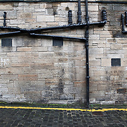 This display of pipes in a neighborhood in Edinburgh, Scotland shows a few things but the main thing is the buildings around town are much older than modern plumbing! Easy Access?