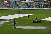 Ground staff working to dry the wicket after heavy overnight rain left the outfield waterlogged and flooded at Somerset County Cricket Club at the Cooper Associates County Ground, Taunton, United Kingdom on 11 April 2018. Picture by Graham Hunt.