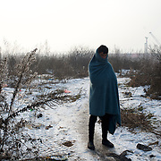 A migrant walks through a frozen field near Belgrade's main railway station.