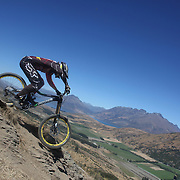 Wyn Masters from New Plymouth, in action during the New Zealand South Island Downhill Cup Mountain Bike series held on The Remarkables face with a stunning backdrop of the Wakatipu Basin. 150 riders took part in the two day event. Queenstown, Otago, New Zealand. 9th January 2012. Photo Tim Clayton
