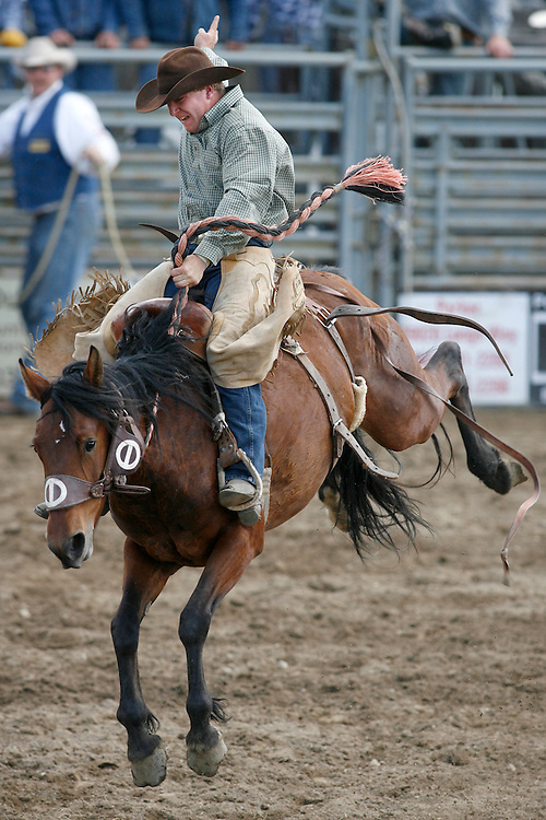 062109-Evergreen, Colo.-saddlebronc-Ryan Dale Bestol, of Hyannis, NE hands on tight to score 72.0 points during the 2009 Evergreen Rodeo PRCA Saddle Bronc Riding Competition Sunday, June 21, 2009 at The Evergreen Rodeo Grounds..Photo By Matthew Jonas/Evergreen Newspapers/Photo Editor