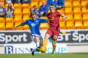 Murray Davidson (#8) of St Johnstone FC tackles David Turnbull (#28) of Motherwell FC during the Ladbrokes Scottish Premiership match between St Johnstone and Motherwell at McDiarmid Stadium, Perth, Scotland on 11 May 2019.