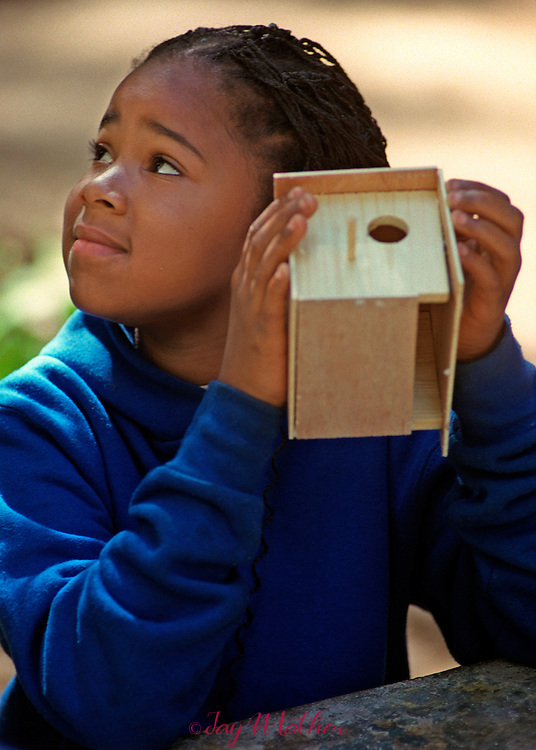 A birdhouse art project finished at Camp Menzies Girl Scout Camp.
