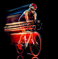 one caucasian woman triathlon triathlete cyclist cycling studio shot  isolated on black background with light painting effect