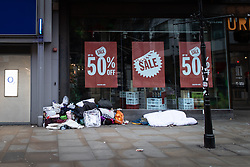 © Licensed to London News Pictures . 25/12/2018 . Manchester , UK . Homeless people sleeping rough outside a branch of Urban Outfitters on Market Street in Manchester City Centre on Christmas Day . Photo credit : Joel Goodman/LNP