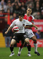Photo: Lee Earle.<br /> Charlton Athletic v Manchester United. The Barclays Premiership. 23/08/2006. United's Ji-Sung Park (front) holds off Luke Young.