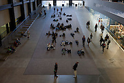 Spectators lie on the ground or look up to experience the art instillation by French artist Philippe Parreno, an experience of sound and light, in the Turbine Hall of Tate Modern, London.